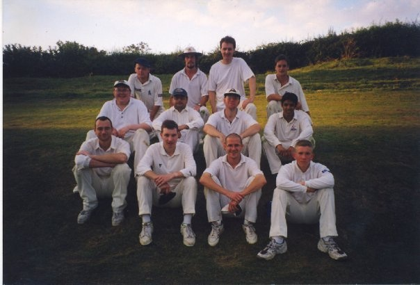 Exiles on tour @ Castle Bytham, 1998. Back Row, left to right: Mark Bradshaw, Jonty Tarbuck, John Priestland, Luke Butler; middle row: Wil Scott, Mitesh Dhanak, Sam Scott, Amil Patel; front row: Kristian Armstrong, Chris Bunton, Robin Airey, Tom Cox